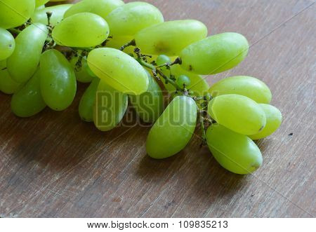 green grape on the wooden board