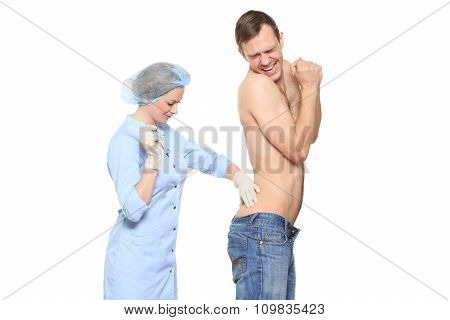 Woman doctor puts a prick. The man is afraid and feels panic. Isolated on white background.