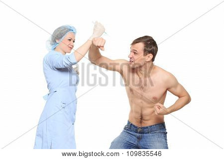Woman doctor puts a prick. The man is afraid and feels panic. Isolated on white background. man does
