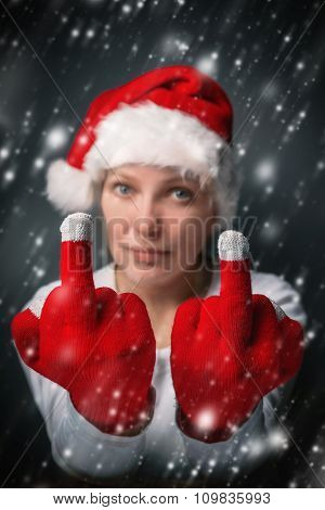 Beautiful Woman In Santa Claus Costume Showing Middle Finger