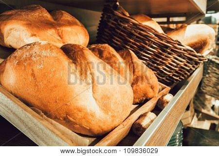 Fresh bread in wooden boxes