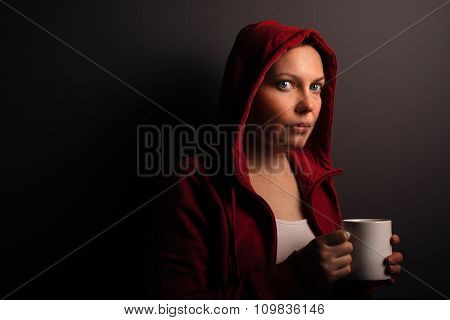 Beautiful Red Hooded Woman Drinking Coffee