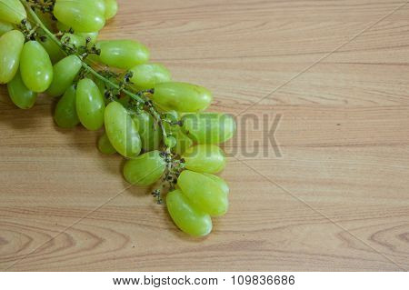 green grape branch on the table