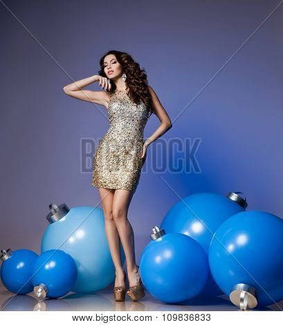Woman with blue Christmas balls