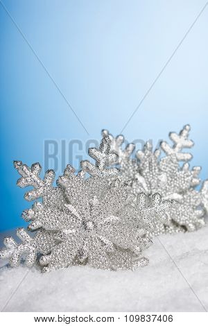 Christmas decoration snowflakes with snow