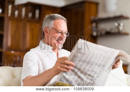 Portrait of a mature man reading a newspaper