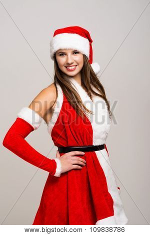 Portrait of a beautiful young girl wearing a Christmas dress