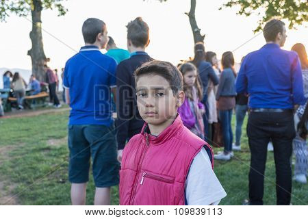 Kid standing in crowd of people