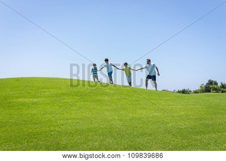 Happy summer vacation for family on green meadow near sea