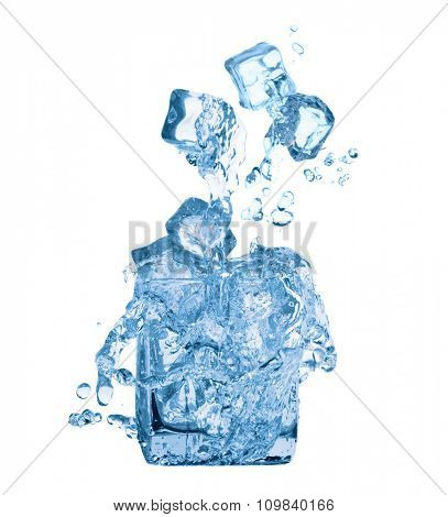 Ice cubes and water in glass isolated