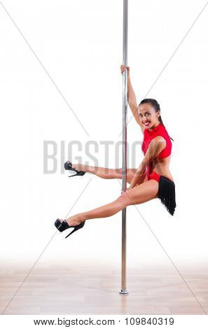 Pole dancer isolated on white