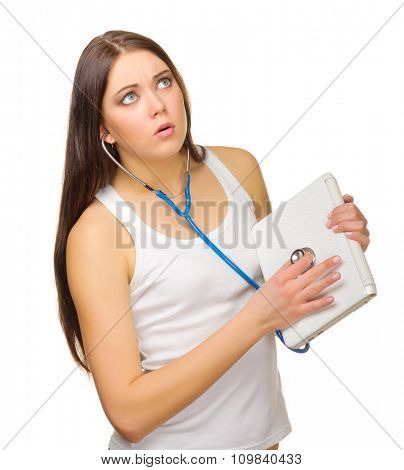 Young girl with laptop and stethoscope isolated