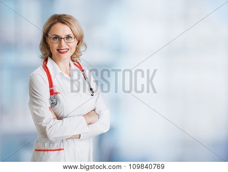 Doctor or physician woman in glasses over abstract medical background