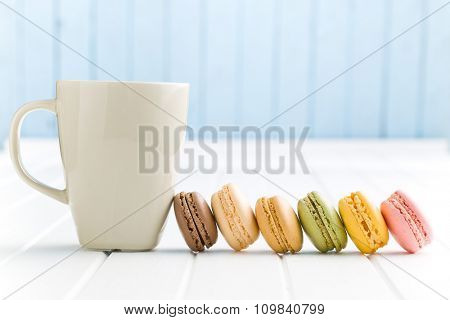 sweet french macarons on white kitchen table