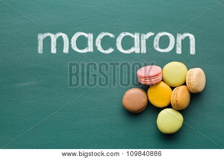 sweet french macarons on chalkboard