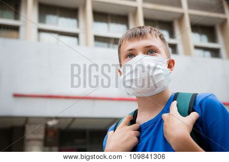 European boy in a protective mask in Beijing, China