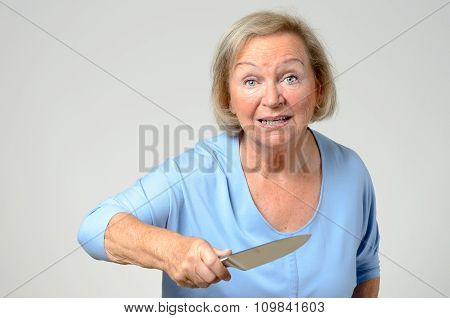Elderly Woman Brandishing A Kitchen Knife