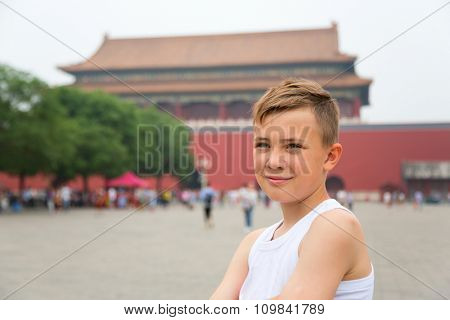 Excitable boy in the Imperial Forbidden City in Beijing