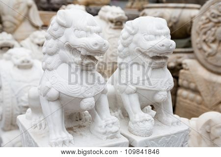 Chinese mythological sculpture in stone at a flea market in Beijing
