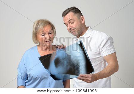 Doctor Discussing An X-ray With A Patient