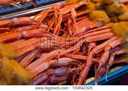Cooked legs crab are on the shopping tray for sale.