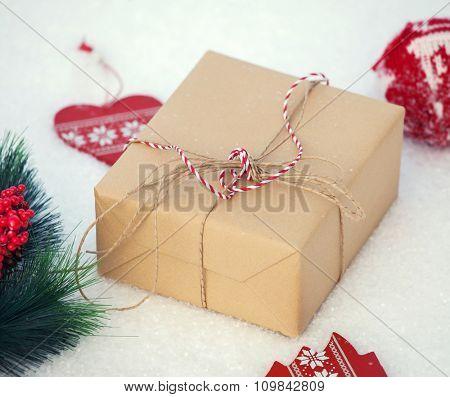 Gift on snow. Decoration on chrismas