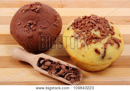 Fresh Baked Muffins And Grated Chocolate On Wooden Spoon