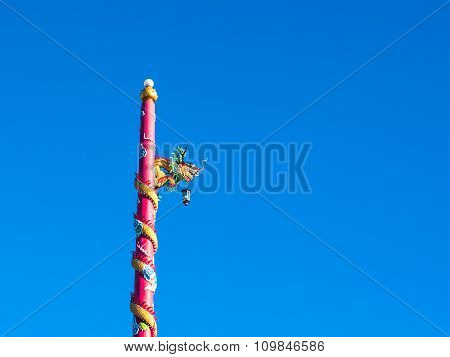Dragon Statue On Blue Sky Background With Blue Space For Text