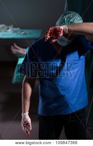 Exhausted Doctor In Sterile Uniform