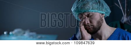 Doctor Grieving Over Lost Patient