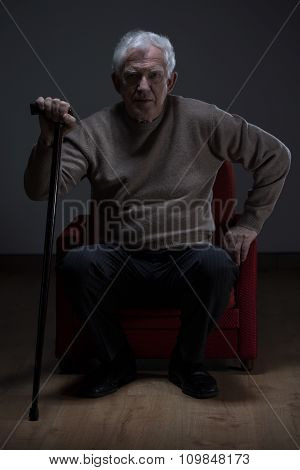 Elder Man With Walking Stick