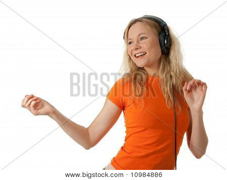 Happy Girl Listening To Music And Dancing