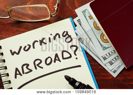 Notebook with the words Working abroad.