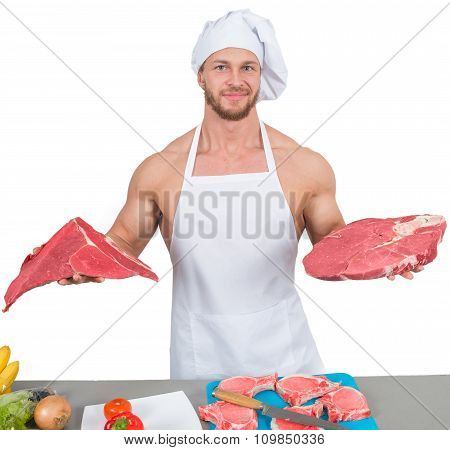chef bodybuilder preparing large chunks of raw meat. natural proteins
