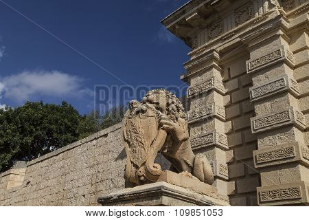 City Gate With Stone Lion To The Medieval Town Mdina, Malta