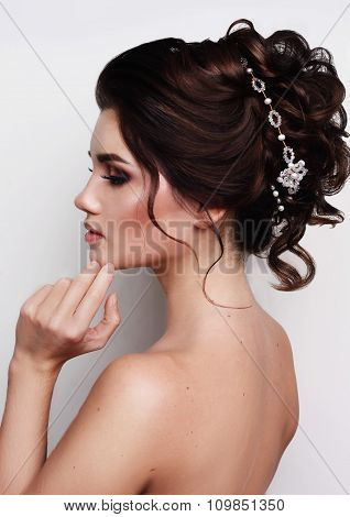 Gorgeous woman with evening head-dress.