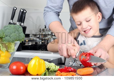food family cooking and people concept - Man chopping paprika on cutting board with knife in kitchen