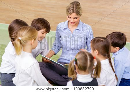 Kids and their teacher at reading session.