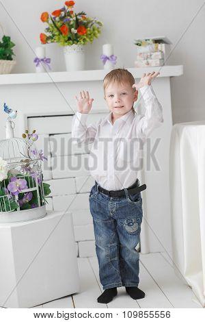 Beautiful Happy Blond Boy Holding