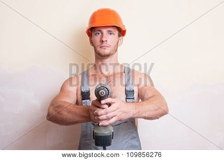 Man Holding A Screwdriver In The Two Arms