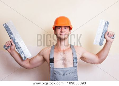Man With Two Spatulas In Hand