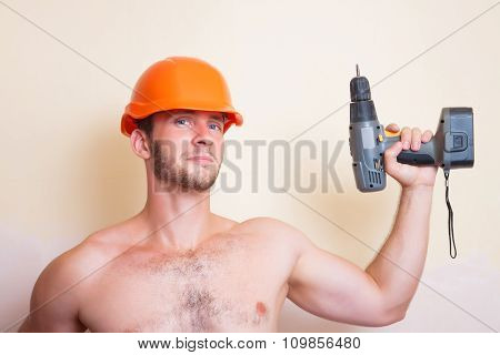 Man In Helmet With A Screwdriver