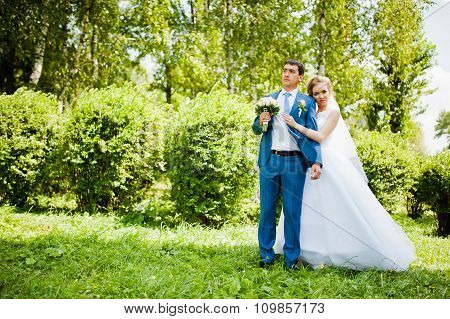 Wedding Couple In Love Walking In Park