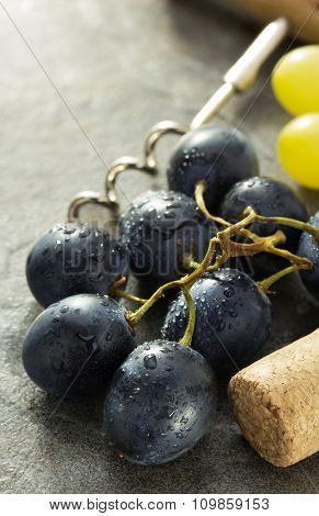 grapes and wine cork on table