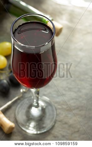 wine glass and grapes on table