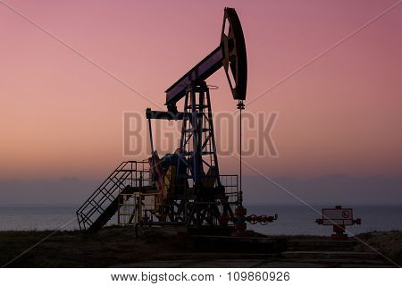 Oil Derricks In Sunset