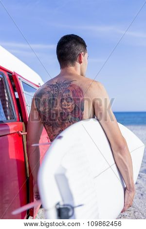 Male Surfer On A Surf Session.