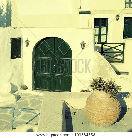 Traditional Houses With Green Doors In Oia, Santorini Island In Greece