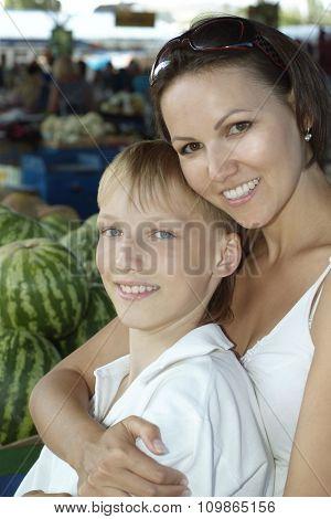 Mom and son  choosing watermelon