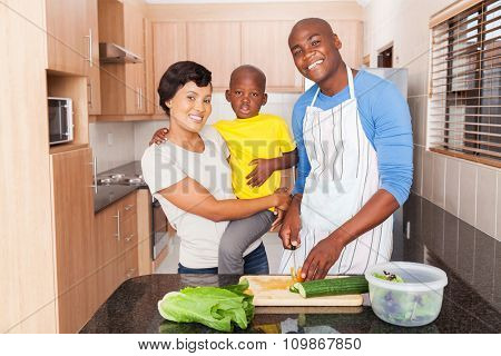 african family preparing lunch at home in the kitchen